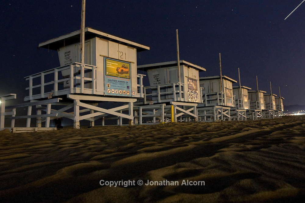 Long exposure of lifeguard towers lined up on Venice Beach on November 12, 2010. .©photo by Jonathan Alcorn