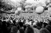 Large spherical inflatables are pushed across a crowd of people, Big Day Out Festival, Perth, Australia 1990s.