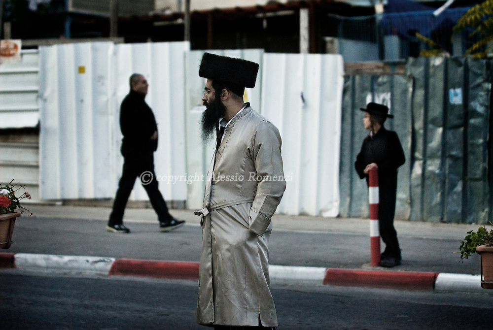 An Ultra-Orthodox Jewish  during a demonstration in the Jerusalem's conservative neighbourhood of Mea Sharim against the opening of a car park during the Sabbath on November 28, 2009. Ultra-Orthodox Jews have been protesting against a decision by secular Mayor Nir Barkat to open the car park on the Sabbath, the Jewish day of rest which runs from Friday sundown to Saturday sundown..© ALESSIO ROMENZI