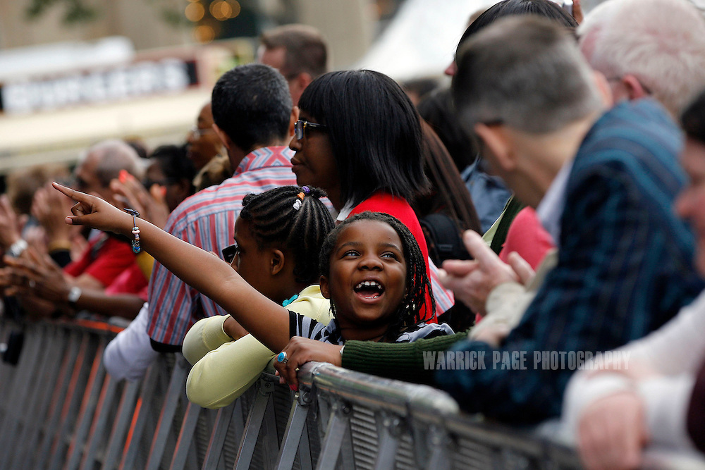 A young girl reacts to a performance at the European venue of the BT River of Music Festival in Trafalgar Square, on July 21, 2012 in London, England. As part of the Cultural Olympiad visitors to London are enjoying a selection of world music at different venues representing Africa, Oceania, the Americas, Asia and Europe. (Photo by Warrick Page)