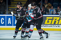 KELOWNA, CANADA - FEBRUARY 14:  Kyle Topping #24 of the Kelowna Rockets is checked between Colin Paradis #2 and Grayson Pawlenchuk #16 of the Red Deer Rebels on February 14, 2018 at Prospera Place in Kelowna, British Columbia, Canada.  (Photo by Marissa Baecker/Shoot the Breeze)  *** Local Caption ***