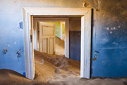 An old abandoned building in the ghost town of Kolmanskop near Luederitz is filled with sand from the Namib Desert, Kolmanskop, Namibia,Africa