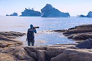 Photographer on the beach in Qeqertarsuaq, Disko Island, Greenland