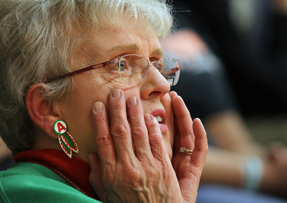Laura Gwaltney reacts to a play at Anderson High School in Anderson, Ind. Gwaltney has had season tickets to the Anderson games since 1953 and was sad to see them move gyms from the historical Wigwam to the more modern Anderson High School gym. ..Photo by Chris Bergin