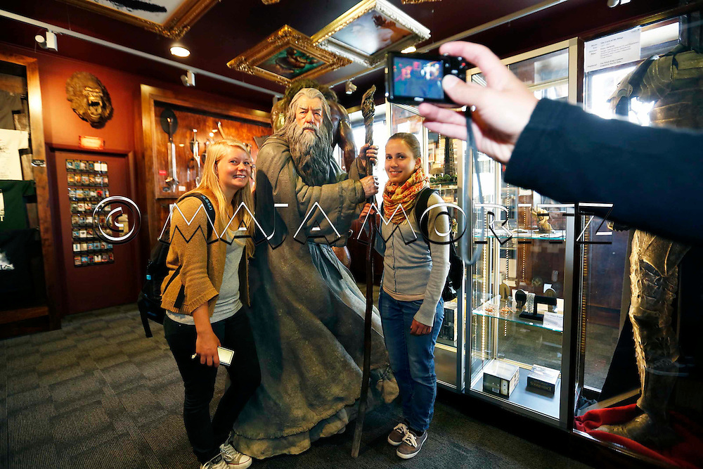 """Gandalf, the wizard, enthralls everyone, here in the Weta Cave, the showroom of the Weta Workshop, where the animations for the Hobbit movies are made, the first movie of the new trilogy  """"The Hobbit: An Unexpected Journey"""" starts in cinemas on 12 December 2012, the German tourists Anna-Maria Bachleitner and Lara-Marie Schwineköper get their picture taken with the magician"""