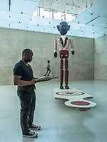 """Theaster Gates, an American Social Practice installation artist from Chicago, Illinois, poses for a Portrait in his """"Black Archive """" exhibition at the Kunstahaus Bregenz."""