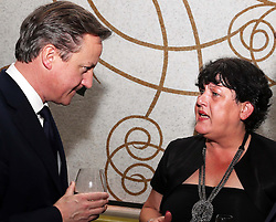 Prime Minister David Cameron talks to Denise Harris, the founder of Afghan Heroes at a fundraising event for the charity in London,   Wednesday, 14th November 2102.  Photo by: Stephen Lock / i-Images