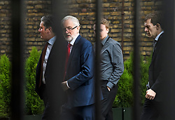 © Licensed to London News Pictures. 25/03/2019. London, UK. Labour Party leader JEREMY CORBYN is seen flanked by Shadow Brexit secretary KIER STARMER (left), policy adviser ANDREW FISHER (centre) and Director of Strategy and Communications SEUMAS MILNE, at the Houses of Parliament, before a meeting with Prime Minster Theresa May. There have been reports of a cabinet revolt against Prime Minister Theresa May, over her handing of the Brexit negotiations.  Photo credit: Ben Cawthra/LNP