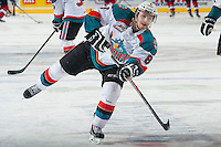 KELOWNA, CANADA - MARCH 23: Colten Martin #8 of the Kelowna Rockets takes a shot during warm up against the Tri-City Americans on March 23, 2014 at Prospera Place in Kelowna, British Columbia, Canada.   (Photo by Marissa Baecker/Shoot the Breeze)  *** Local Caption *** Coleten Martin;