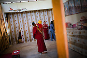 Random tourists and Buddhist followers alike wait in line outside a room to receive blessings from Thupstan Ngawang, born 24 November 2005, the recognized reincarnation of Ladakh's late head Lama, Kushok Bakula Rinpoche, who passed away on 4 November 2003. 2 monks tend to the toddler reincarnation as he receives throngs of visitors who have heard news of his being at the Sumur Gompa in Sumur, Nubra Valley, Ladakh on 5th June 2009.  Photo by Suzanne Lee