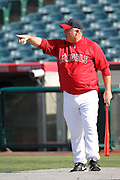 ANAHEIM, CA - APRIL  23:  Team manager Mike Scioscia #14 of the Los Angeles Angels of Anaheim points while directing batting practice before the game between the Boston Red Sox and the Los Angeles Angels of Anaheim on Saturday, April 23, 2011 at Angel Stadium in Anaheim, California. The Red Sox won the game in a 5-0 shutout. (Photo by Paul Spinelli/MLB Photos via Getty Images) *** Local Caption *** Mike Scioscia