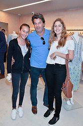 Left to right, FRANCESCA MOUFARRIGE, TIM MOUFARRIGE and NATASHA MOUFARRIGE at a party to celebrate the re-launch of the Ghost Flagship store at 120 King's Road, London on 15th April 2015.