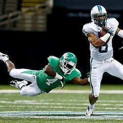 Oct 5, 2013; New Orleans, LA, USA; Tulane Green Wave cornerback Lorenzo Doss (6) runs past North Texas Mean Green wide receiver Darvin Kidsy (4) after intercepting a pass during the first half at Mercedes-Benz Superdome. Mandatory Credit: Derick E. Hingle-USA TODAY Sports