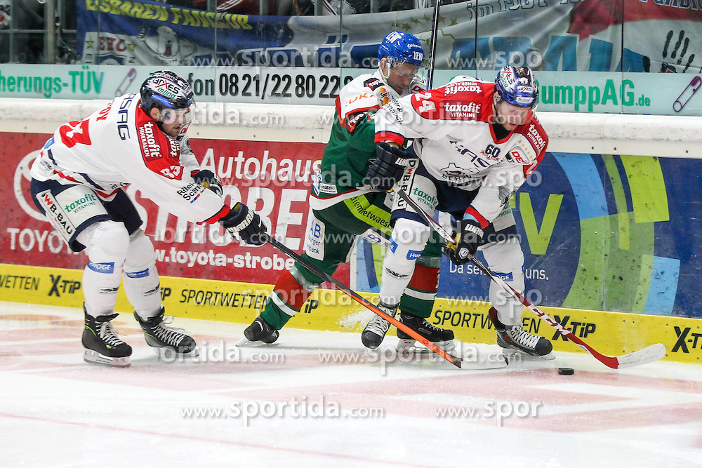 21.12.2014, Curt-Fenzel-Stadion, Augsburg, GER, DEL, Augsburger Panther vs Eisbaeren Berlin, 29. Runde, im Bild l-r: im Zweikampf, Aktion, mit Matt Foy #83 (Eisbaeren Berlin), Arvids Rekis #37 (Augsburger Panther) und Andre Rankel #24 (Eisbaeren Berlin) // during Germans DEL Icehockey League 29th round match between Augsburger Panther and Eisbaeren Berlin at the Curt-Fenzel-Stadion in Augsburg, Germany on 2014/12/21. EXPA Pictures © 2014, PhotoCredit: EXPA/ Eibner-Pressefoto/ Kolbert<br /> <br /> *****ATTENTION - OUT of GER*****