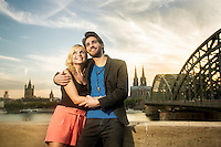 young couple spending time in summer in cologne and enjoying the good weather