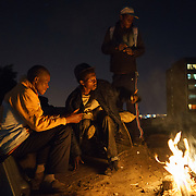 """""""Nyaope"""" drug addicts gather nightly in """"Highrise Park"""" on the edge of Hillbrow, an inner-city Johannesburg neighbourhood with a notorious reputation.  A crude form of heroin reputedly cut with anything from anti-retrovirals to rat poison to pool cleaner, nyaope is either injected or smoked with a mixture of cannabis and tobacco. The drug is cheap (about R20/ $1.70 per """"round"""") and devastatingly addictive - it produces a brief high, but then leaves the user with vicious withdrawal symptoms, constantly searching for the next high."""