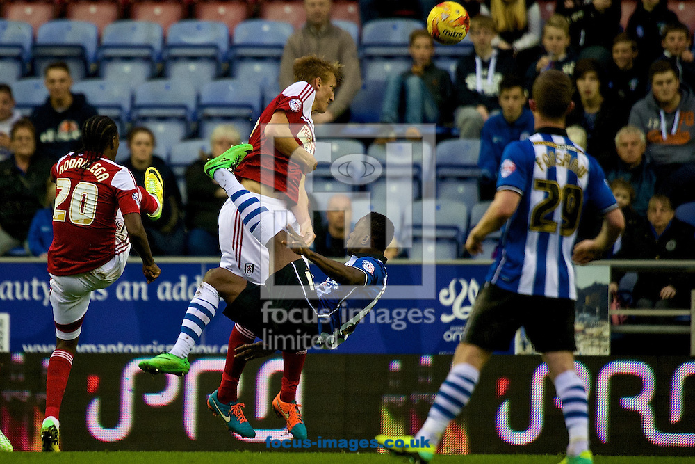 Maynor Figueroa of Wigan Athletic attempts an overhead kick during the Sky Bet Championship match at the DW Stadium, Wigan<br /> Picture by Ian Wadkins/Focus Images Ltd +44 7877 568959<br /> 01/11/2014