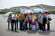 "A group of tourists at the entrance to ""The Forbidden City"" which was the Chinese imperial palace from the Ming Dynasty to the end of the Qing Dynasty. It is located in the middle of Beijing, China. Beijing is the capital of the People's Republic of China and one of the most populous cities in the world with a population of 19,612,368 as of 2010."
