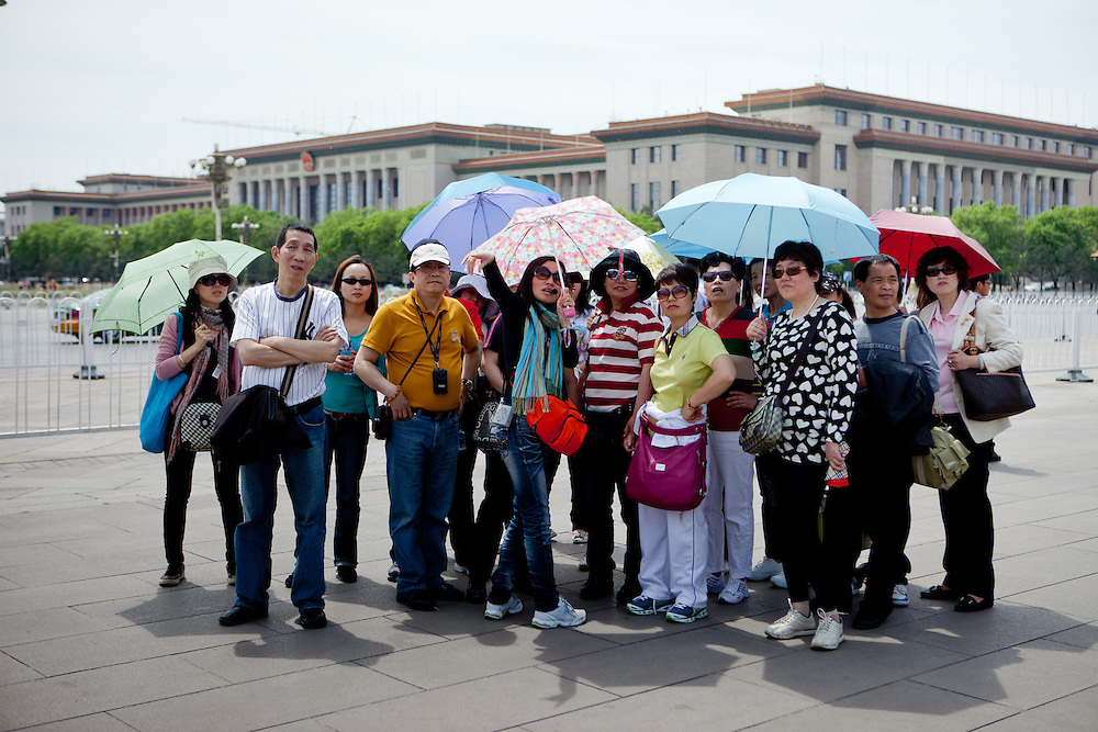 """A group of tourists at the entrance to """"The Forbidden City"""" which was the Chinese imperial palace from the Ming Dynasty to the end of the Qing Dynasty. It is located in the middle of Beijing, China. Beijing is the capital of the People's Republic of China and one of the most populous cities in the world with a population of 19,612,368 as of 2010."""