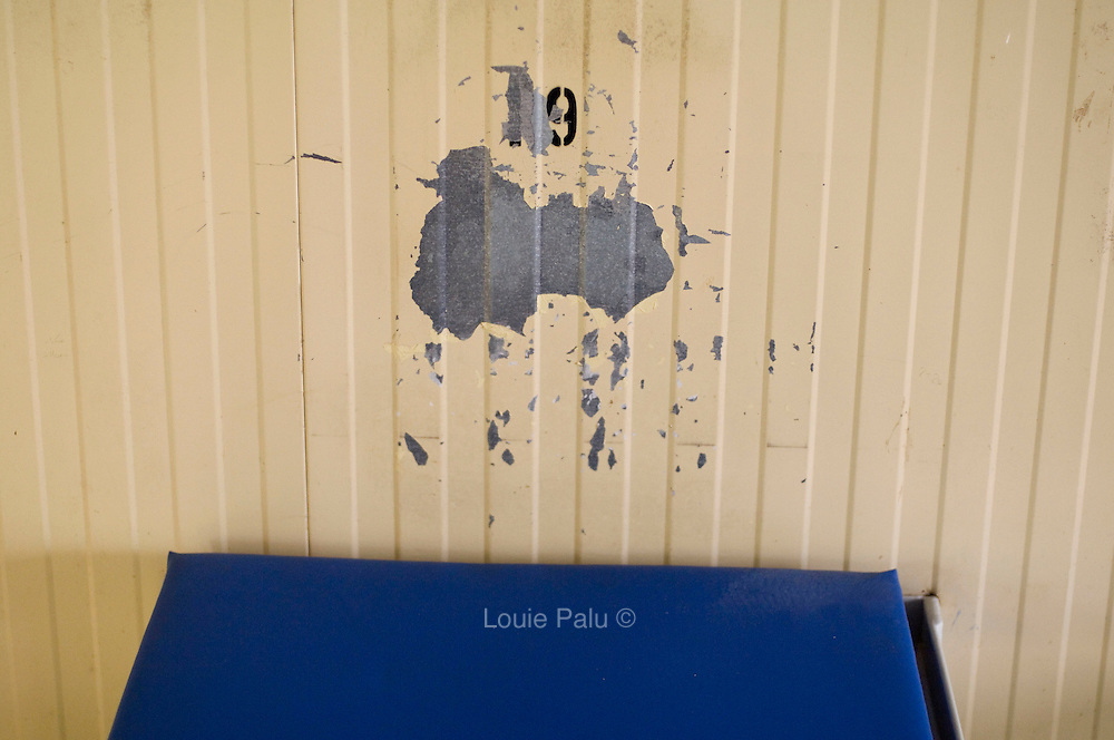 """Peeled and chipped paint on a wall above a detainee's bed in Camp 4 at the detention facility in Guantanamo Bay, Cuba. Approximately 250 """"unlawful enemy combatants"""" captured since the September 11, attacks on the United States continue to be held at the detention facility.(Image reviewed by military official prior to transmission)"""