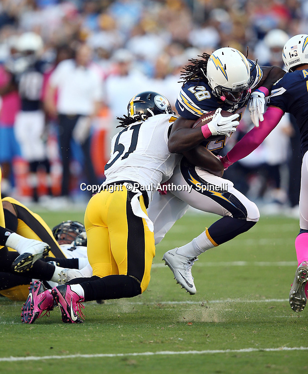 San Diego Chargers running back Melvin Gordon (28) gets tackled by Pittsburgh Steelers inside linebacker Sean Spence (51) as he runs the ball during the 2015 NFL week 5 regular season football game against the Pittsburgh Steelers on Monday, Oct. 12, 2015 in San Diego. The Steelers won the game 24-20. (©Paul Anthony Spinelli)