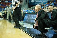 19 MAR 2015: Larry Davis of University of Cincinnati coaches the Bearcats to take on Purdue University during the 2015 NCAA Men's Basketball Tournament held at the KFC Yum! Center in Louisville, KY. Cincinnati defeated Purdue 66-65 in overtime. Brett Wilhelm/NCAA Photos