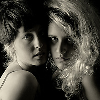 Close up of two female teenagers faces