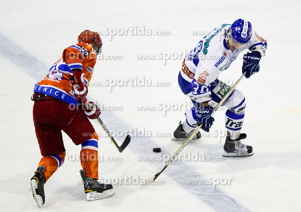 Rok Ticar of Acroni Jesenice vs Frank Banham of Medvescak during ice-hockey match between HK Acroni Jesenice and KHL Medvescak Zagreb in 8th Round of EBEL league, on October 3, 2010 at Arena Podmezakla in Jesenice, Slovenia. (Photo By Vid Ponikvar / Sportida.com)