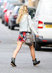 Girls Aloud singer Sarah Harding wearing a denim jacket, short poppy dress, studded belt and black boots out and about in north London, UK. 11/09/2012<br />BYLINE MUST READ : GOTCHAIMAGES.COM<br /><br />Copyright by © Gotcha Images Ltd. All rights reserved.<br />Usage of this image is conditional upon the acceptance <br />of Gotcha Images Ltd, terms and conditions available at<br />www.gotchaimages.com