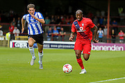 Anthony Straker & Sam Hutchison during the Friendly match between York City and Sheffield Wednesday at Bootham Crescent, York, England on 18 July 2015. Photo by Simon Davies.