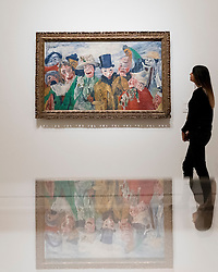 "© Licensed to London News Pictures. 25/10/2016. London, UK.  A staff member views ""The Intrigue, 1890"" at the preview of Intrigue: James Ensor by Luc Tuymans.  Curated by fellow Belgian artist Luc Tuymans, this is the first exhibition of work by modernist artist James Ensor (1860-1949) to be held in the UK in twenty years and will run 29 October 2016 to 29 January 2017. Photo credit : Stephen Chung/LNP"