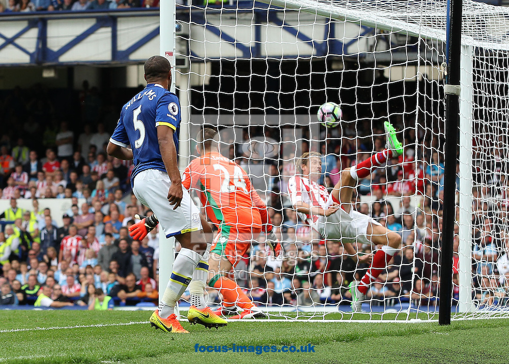 Peter Crouch of Stoke City clears Phil Jagielka of Everton, attempt on goal during the Premier League match at Goodison Park, Liverpool.<br /> Picture by Michael Sedgwick/Focus Images Ltd +44 7900 363072<br /> 27/08/2016