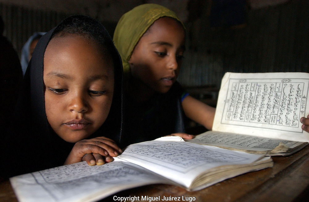 Dessie, Ethiopia: Ethiopian Muslims and Christians have traditionally been moderate in their faith, placing ethnicity, or nationalism, above religious ideology. In recent years, however, young Ethiopians in particular have been embracing more fundamentalist strains of Islam and Orthodox Christianity. Here, young Muslim girls learn to read the Koran in Arabic at a madrassa, the Showber Islamic School, in Dessie. Ethiopia's official lenguage is Amharic.  (PHOTO: MIGUEL JUAREZ LUGO).
