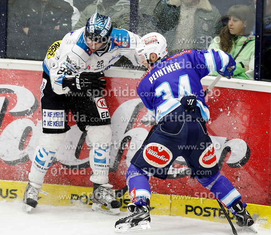 08.03.2013, Stadthalle, Villach, AUT, EBEL, EC VSV vs EHC Black Wings Linz, Playoff best of seven, 6. Runde, im Bild Brett Engelhardt (Linz,#22) und Markus Peintner (VSV,#34) // during the Erste Bank Icehockey League playoff best of seven 6th round between EC VSV vs EHC Black Wings Linz at the City Hall, Villach, Austria, 2013/03/08, EXPA Pictures © 2013, PhotoCredit: EXPA/ Oskar Hoeher