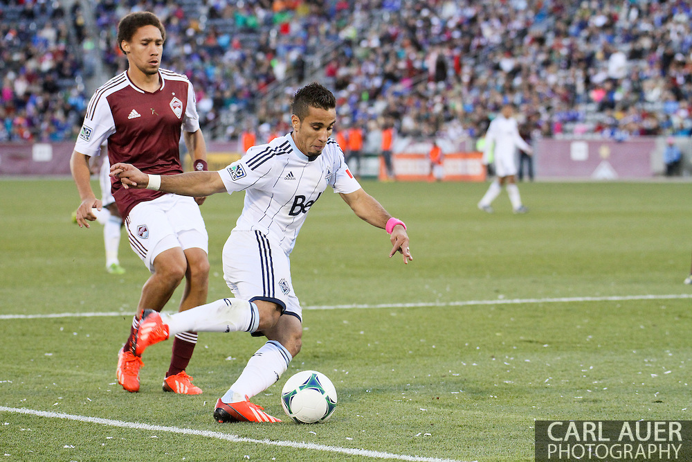 October 19th, 2013:  Vancouver Whitecaps FC forward Camilo Sanvezzo (7) attempts a shot in front of Colorado Rapids defender Chris Klute (15) in the second half of the MLS Soccer Match between the Vancouver Whitecaps FC and the Colorado Rapids at Dick's Sporting Goods Park in Commerce City, Colorado
