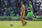 Cambridge United's Greg Taylor(5) passes the ball forward during the EFL Sky Bet League 2 match between Forest Green Rovers and Cambridge United at the New Lawn, Forest Green, United Kingdom on 22 April 2019.