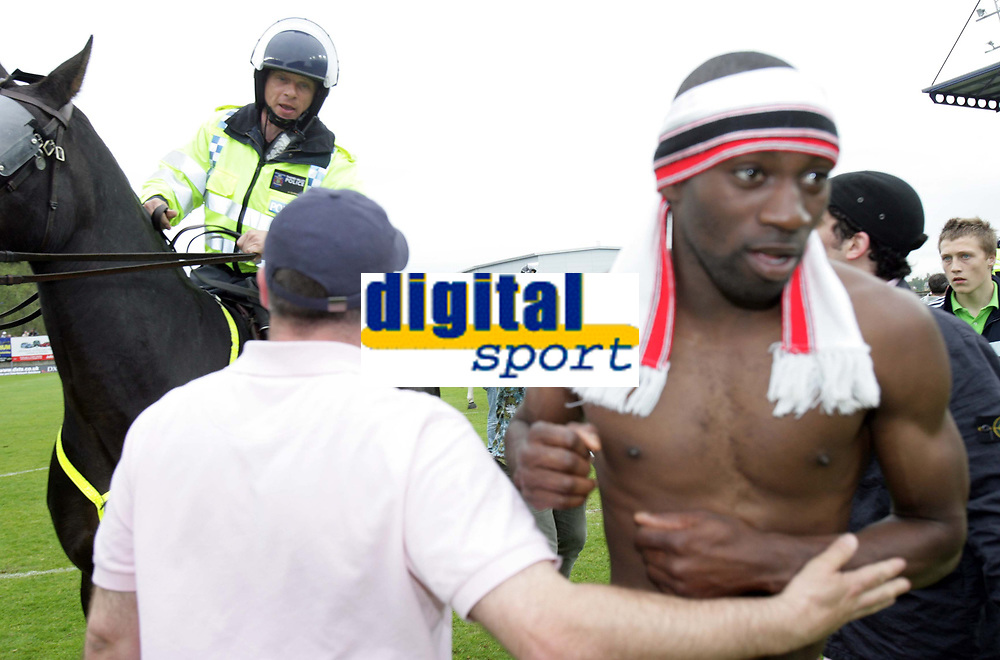 Photo: Rich Eaton.<br /> <br /> Oxford United v Leyton Orient. Coca Cola League 2. 06/05/2006.<br /> <br /> Leyton Orient player Jabo Ibehre (right) celebrates on the pitch as a mounted police office tries to guide fans off the pitch