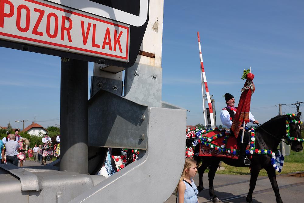 Riders in Kunovice, crossing railroad tracks, at the Jizda Kralu, Ride of the Kings.
