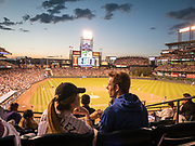 A couple take in the game, the sunset and each other ast the Colorado Rockies play the Los Angeles Dodgers in Denver.