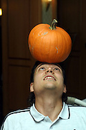 03.10.2001, Essen, Germany. Jari Litmanen plays with a pumpkin at the Finnish National team hotel before the match v Germany..©JUHA TAMMINEN