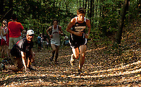 Kyle Wiley makes his way up the final hill during the Cross Country meet at MVHS Tuesday afternoon.  (Karen Bobotas/for the Concord Monitor)