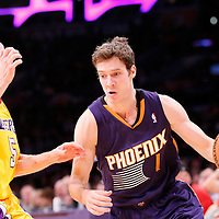 10 December 2013: Phoenix Suns shooting guard Goran Dragic (1) drives past Los Angeles Lakers point guard Steve Blake (5) during the Phoenix Suns 114-108 victory over the Los Angeles Lakers at the Staples Center, Los Angeles, California, USA.