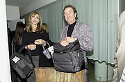 Mr. & Mrs. Eric Idle with gift bags leaving the Talk pre-globe Awards Party. Mondrian, Los Angeles. 22/1/2000. <br />