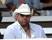 Toby Keith watches the races on Travers Stakes day
