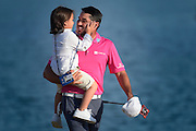 PONTE VEDRA BEACH, FL - MAY 15:Jason Day of Australia carries his son Dash on the 18th green  during the final round of THE PLAYERS Championship on THE PLAYERS Stadium Course at TPC Sawgrass on May 15, 2016. (Photo by Chris Condon/PGA TOUR)