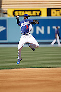 LOS ANGELES, CA - MAY 28:  Dee Gordon #9 of the Los Angeles Dodgers leaps and throws as he plays the field during the game against the Milwaukee Brewers on Monday, May 28, 2012 at Dodger Stadium in Los Angeles, California. The Brewers won the game 3-2. (Photo by Paul Spinelli/MLB Photos via Getty Images) *** Local Caption *** Dee Gordon