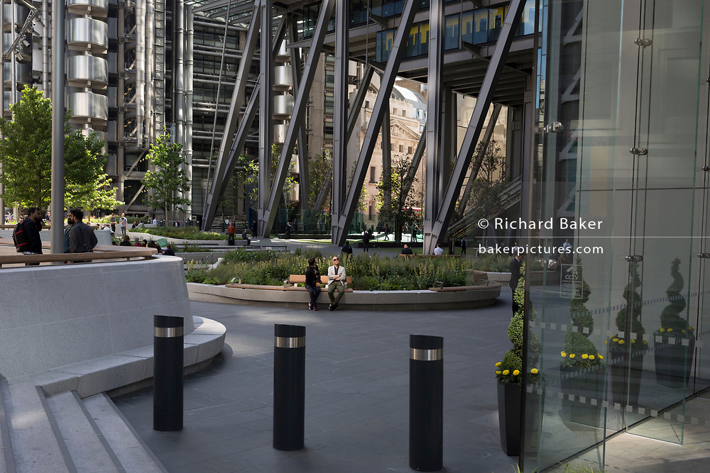 Architecture outside the Leadenhall building and Lloyds of London  in the City of London - the capital's financial district, on 6th June 2018, in London, England.