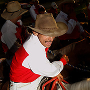 SAN CARLOS, PANAMA - FEBRUARY 11: A cowboy cheers as a teamate competes in a lasso competition in San Carlos, near Boquete, Panama, on February 11, 2007. In the competition, each heat features one town's team versus another in a tournament bracket style. The speed of the calf's capture determines points.  (Photo by Logan Mock-Bunting)