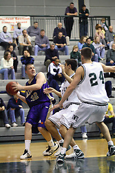 30 December 2006: Jim Cash leans away from the Titan defense.The Titans outscored the Britons by a score of 94-80. The Britons of Albion College visited the Illinois Wesleyan Titans at the Shirk Center in Bloomington Illinois.<br />