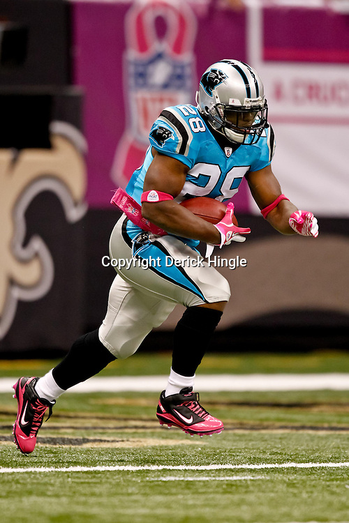 October 3, 2010; New Orleans, LA, USA; Carolina Panthers running back Jonathan Stewart (28) during warm ups prior to kickoff of a game between the New Orleans Saints and the Carolina Panthers at the Louisiana Superdome. Mandatory Credit: Derick E. Hingle
